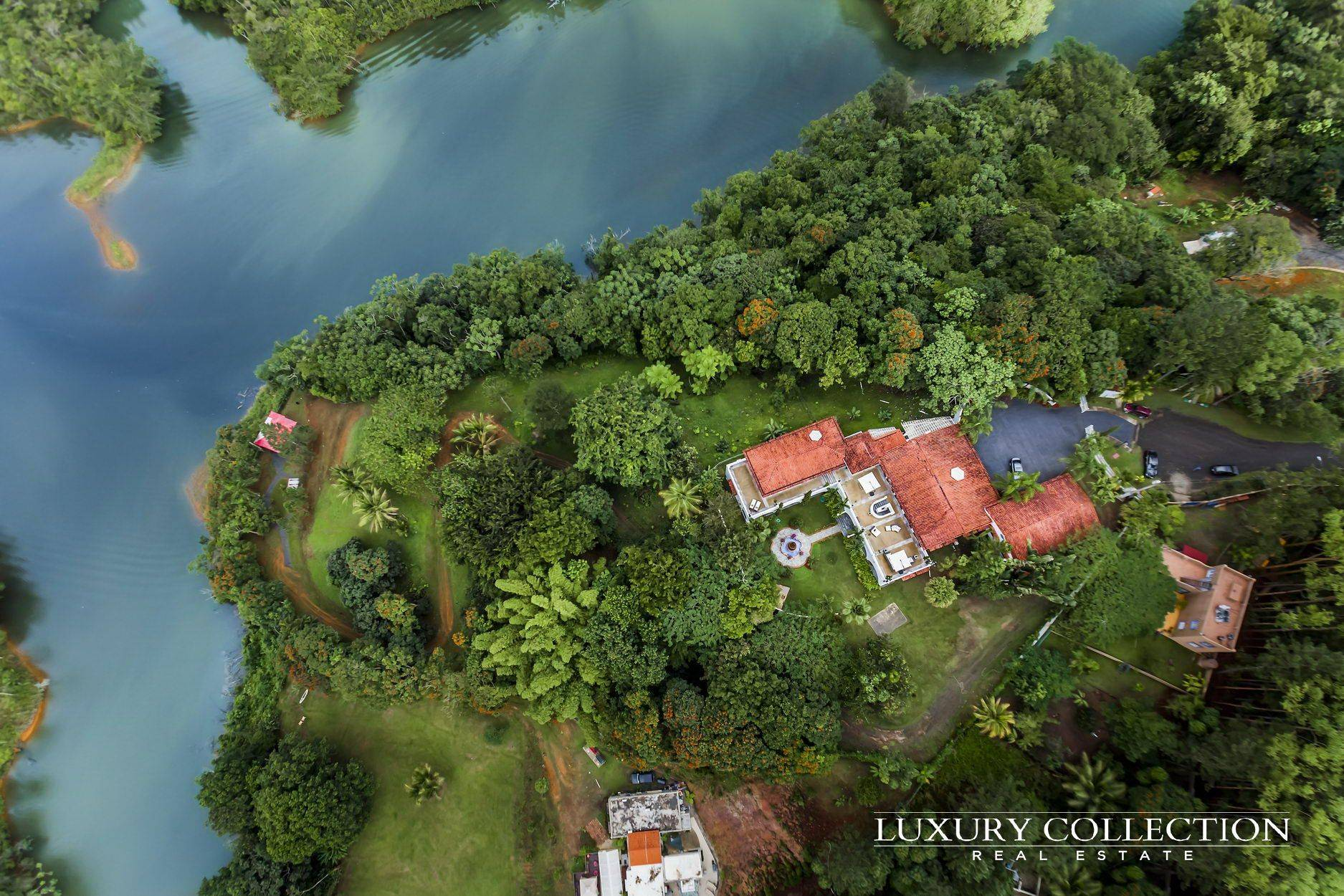 Lakefront Mansion for rent Puerto Rico in the Mountains in Cidra La Peninsula