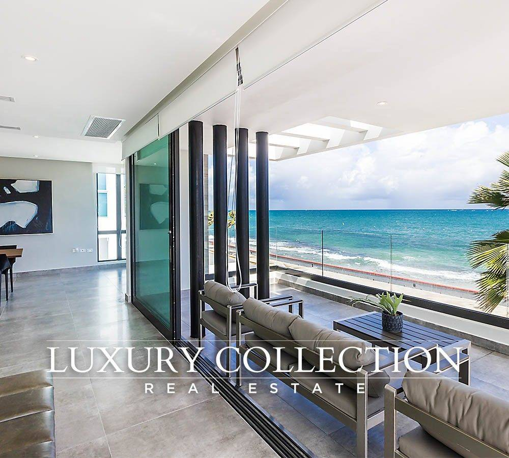 Beachfront house for sale Park Boulevard at Ocean Park in Condado Puerto Rico. Brand new contemporary luxury real estate with ocean views and rooftop pool.