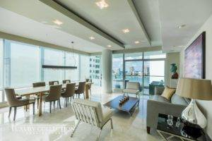 Cosmopolitan condominium for sale in Miramar Puerto Rico, Floor to ceiling glass walls expose dramatic views including city, ocean and Condado Lagoon.